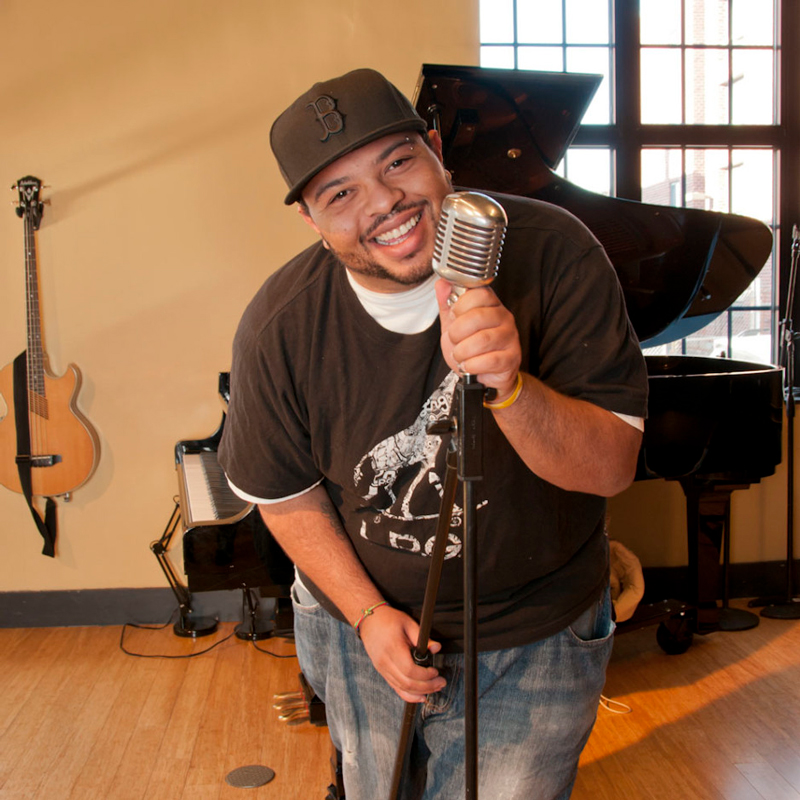 Corey DePina teaches rap and hip hop culture workshops for schools in Massachusetts