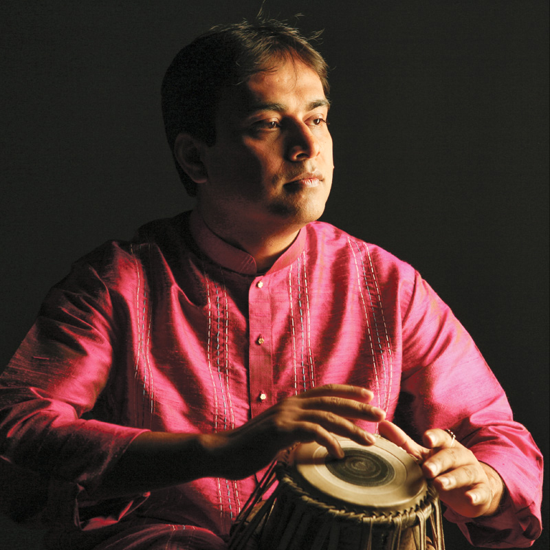 Sandeep Das performs a Northern Indian music program for schools
